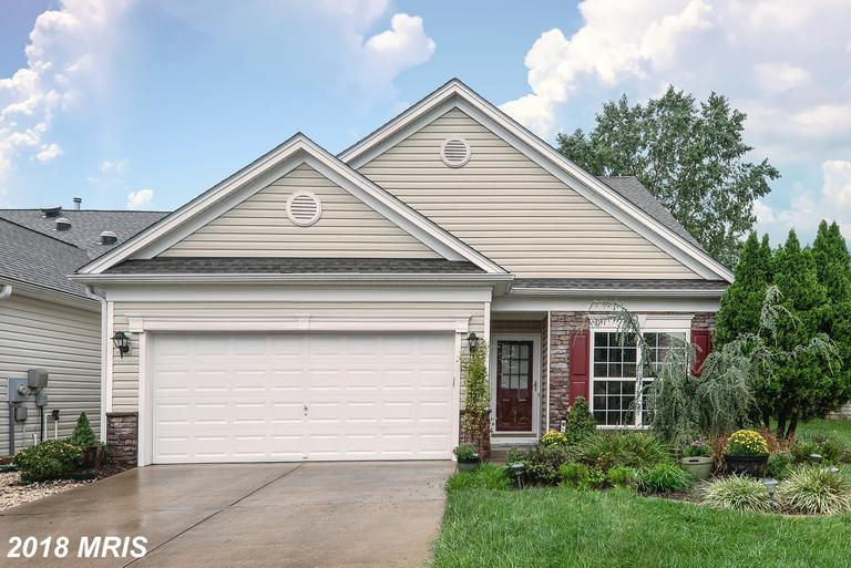 Beautiful Falls Run Home!  Elegant Entry with Hardwood Floor and Moulding, Open and Airy Floor Plan,