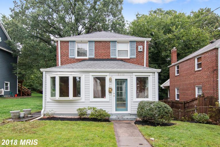 "The elusive ""green granny"" house! 1940s brick colonial on a quiet, tree-lined street with vintage 19"