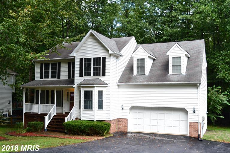 Come and see this awesome 3 level colonial  with 5 large bedrooms and 3 1/2 baths. Family room with