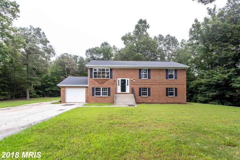 Beautiful 4BR/3BA on private & wooded 4+ acres in wonderful condition & ready for move-in! Main leve