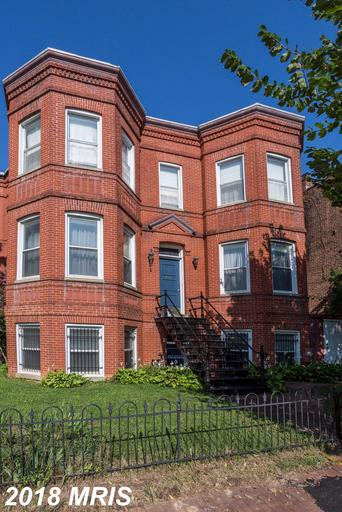 THE STATELY HOUSE ON THE CORNER WITH GREAT LOT! THIS GRACIOUS CENTER STAIR VICTORIAN HAS TWO BAYS, H