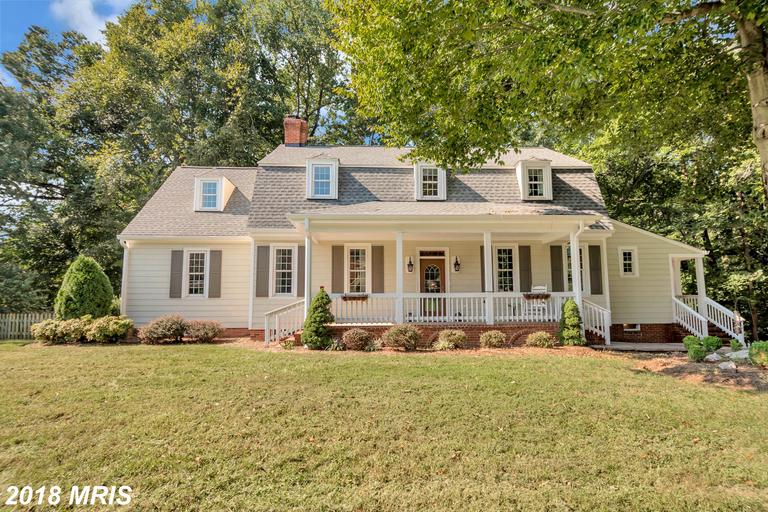 Expansive Dutch Colonial w/ tons of character & charm. Story book setting backs to creek w/ walking