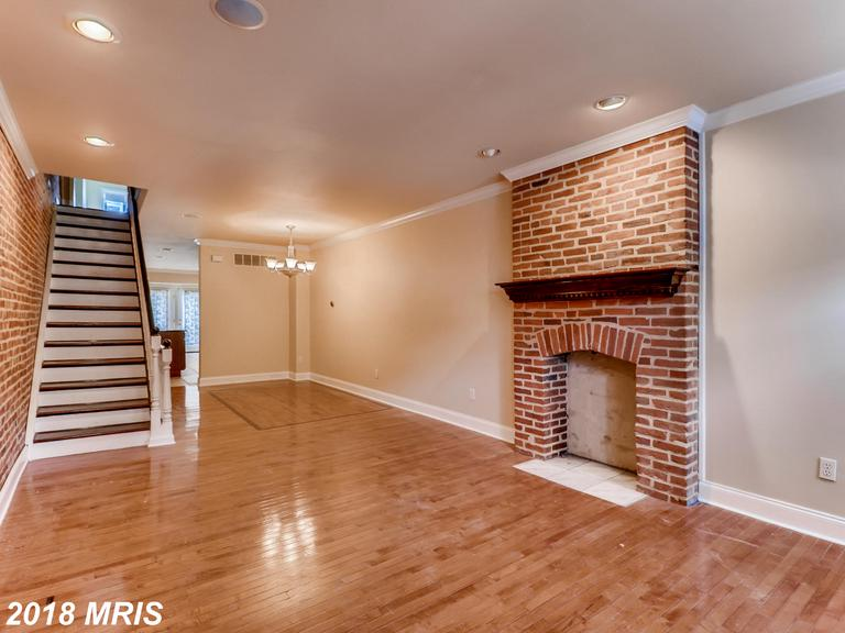 "Roof Top Deck w/ Water and City Views. Gorgeous Original Hardwood Floors, Exposed Brick, Gourmet Kitchen w/ 42"" Cherry Cabinets and Over-Sized Island. New Appliances and Carpet. Walk to the Shops at Canton Crossings, the Bustling Canton Square, or the Popular Patterson Park. Easily Accessible to I-95, I-895, and  Downtown Harbor. Make and Offer and get settled before the holidays."