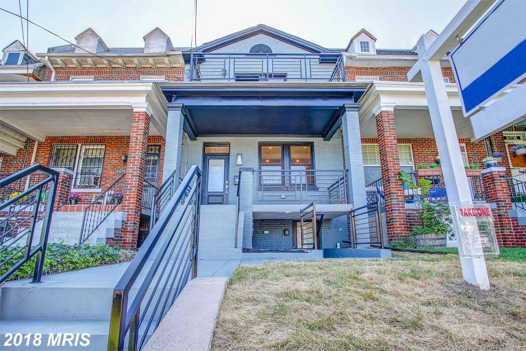 Over 2000 sq ft.Stunning renovated attached row house  w/front porch located on Kansas avenue  in  p