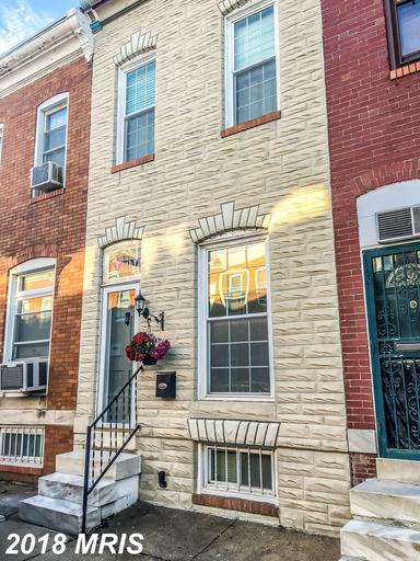 THIS CHARMING ROW HOUSE IS JUST STEPS FROM PATTERSON PARK,  IT FEATURES HARDWOOD FLOORS THROUGH-OUT,