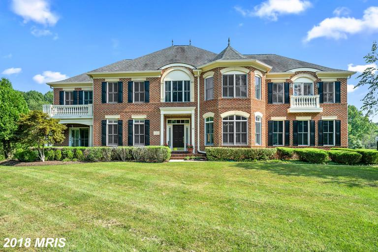SPECTACULAR BRICK HOME ON 2-ACRE WOODED LOT PLANNED & DESIGNED FOR GRAND SCALE ENTERTAINING! 2-STORY FOYER W/MARBLE FLRS, CURVED STAIRCASE. GOURMET KIT W/ISLAND, GRANITE & JENNAIR APPL OPENS TO SUNRM & 2-STORY FAM RM W/COFFERED CEILING & GAS FP. HWD FLRS. OWNERS SUITE W/HWD, BAR, SITTING RM & 2 WALK IN CLOSETS. 3 ADDT'L BR'S & 2 BA'S COMPLETE THE UPPER LVL. WRAP AROUND DECK & 3 CAR SIDE LOAD GAR.