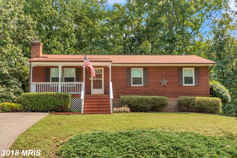 RARE GEM ON OVER 1 ACRE IS SO CONVENIENTLY LOCATED! Wonderful 2 Story Rambler has 4 Bedrooms, 3 Full