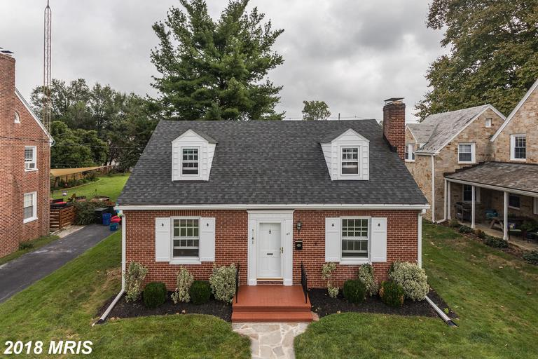 Adorable all brick cape cod with a 5 min walk to downtown Westminster! This home offers gleaming har