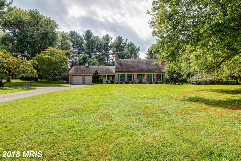 Quality built Classic, all brick cape on a lovely lot. Main floor bedroom, 3 fireplaces, slate floor