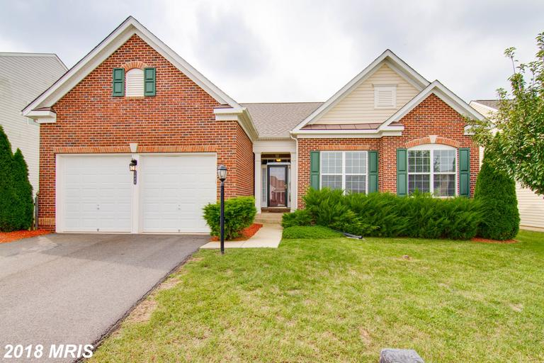 Located in the desirable Somerset, This immaculate  home features an open floor plan with a two sided fireplace. Spacious kitchen loaded with granite countertops, hardwood and stainless appliances. Main level master with luxury bath. Spacious bedrooms Finished basement offers a large family room and  half bathroom & room to expand or use for storage. Enjoy the fenced in backyard.