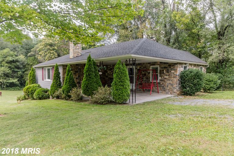 3 Beds/2 Bath on almost an Acre,only 2 Miles from WMC! Brand New Flooring & Paint throughout. Large