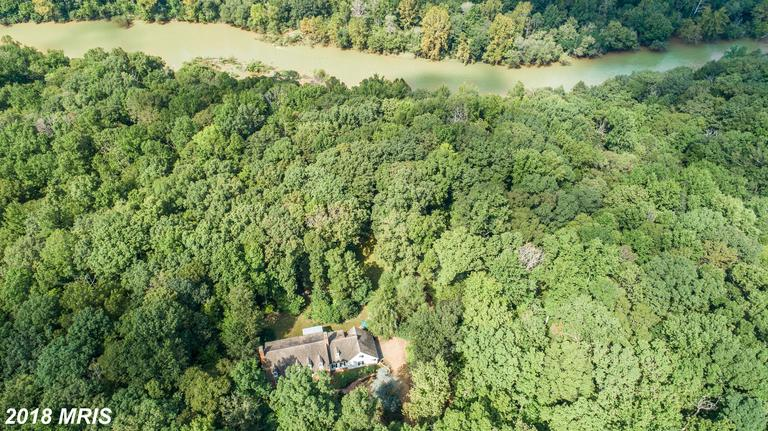 Stunning Estate Home, surrounded by 12 low maintenance acres on a bluff overlooking the Rappahannock