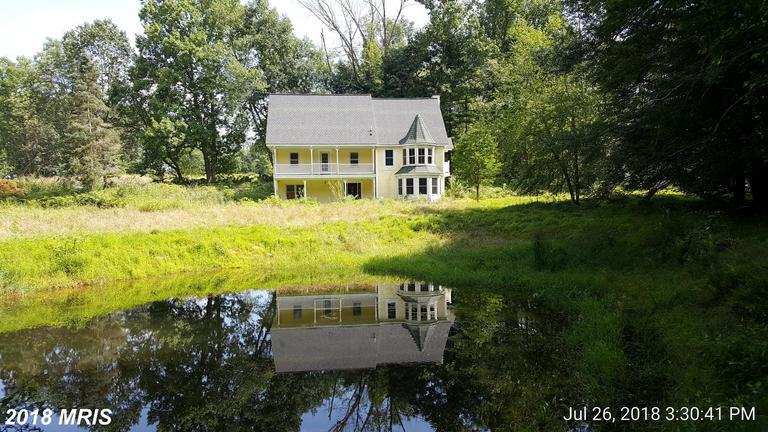 Located in a private setting on 12 acres with pond and stream (Little Catoctin Creek), this home was