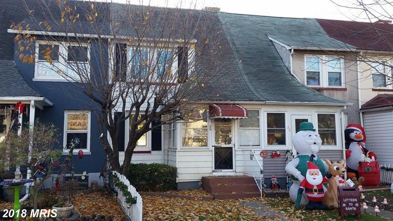 Charming updated rowhome in Dundalk w/ off street parking! Solid construction w/ beautiful hardwood