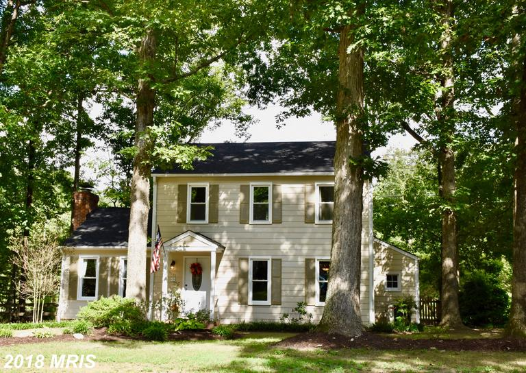 Charming Colonial located in the sought-after Creekwood community featuring an updated kitchen, hard
