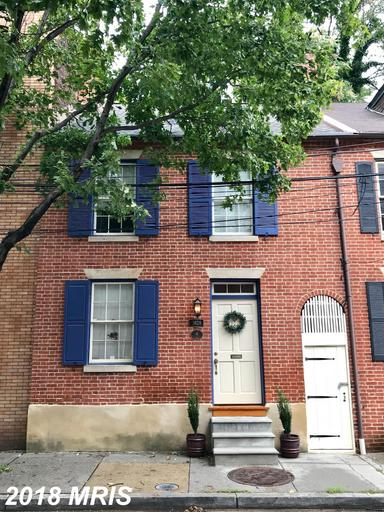 Rare opportunity to own an historic 1800 home on one of the most charming streets in Fell's Point.
