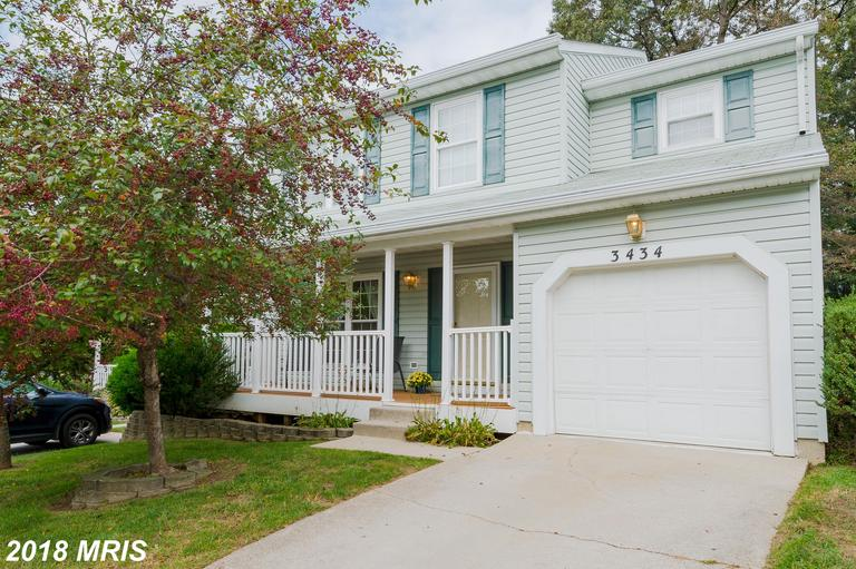Lovely Colonial w/updated Kitchen & Family Rm addition & offering hardwood flooring in Living Rm & D