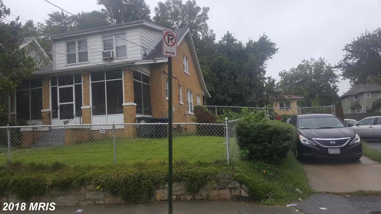 This Huge 5-bedroom, 2 bath, all Brick home features Off-Street parking for 3-4 cars, huge cornered